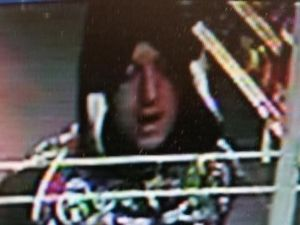 Image released in hunt for petrol station's armed robber