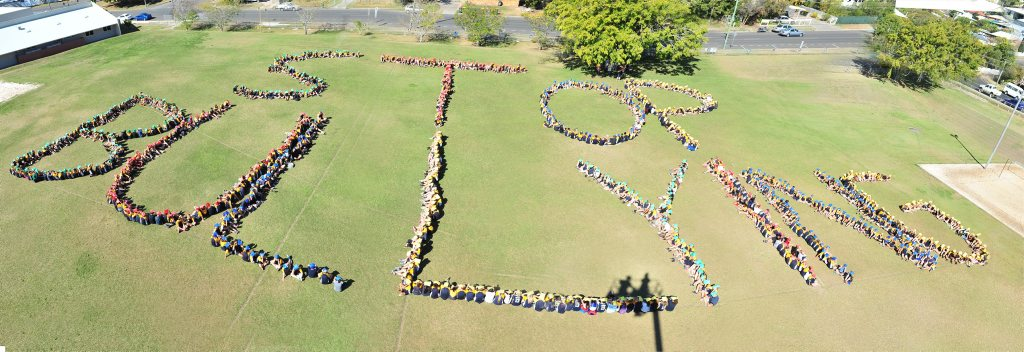 Gladstone State High School students show their support for a mental health awareness campaign by spelling out the words stop bullying' on their school oval. Photo Christopher Chan / The Observer
