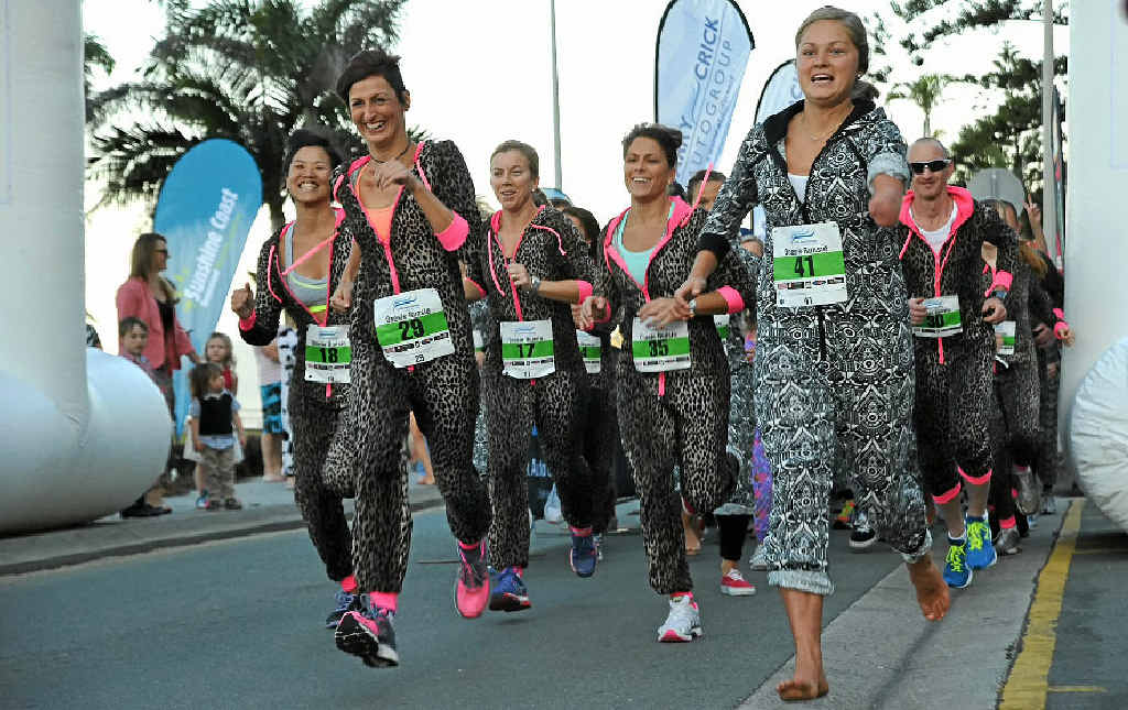 THEY'RE OFF: Runner charge off the starting line in the Cricks Onesie Runsie at Mooloolaba.