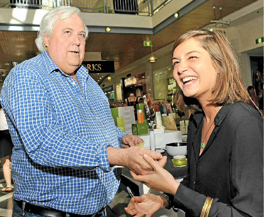 SWEET AS: Clive Palmer gets a manuka honey peel sample from Organi staff member Gal Goldwasser at Maroochydore Plaza shopping centre.
