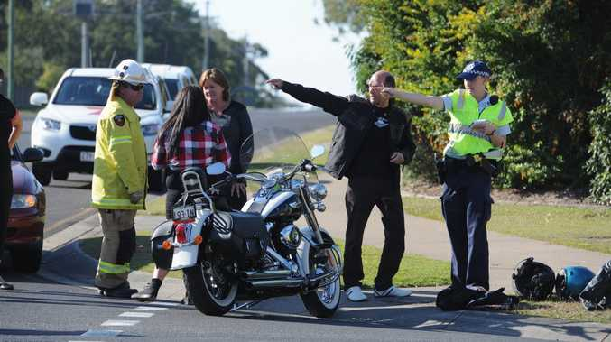 Police talk with motorcycle riders after an alleged hit-and-run crash in Torquay on Saturday.
