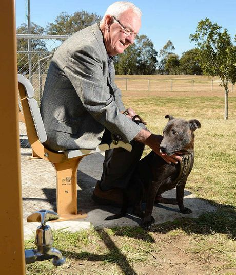 DOGGONE: Bill Hayden with Diesel at the launch of The Drover's Dog Off-Leash Dog Park at Rosewood.