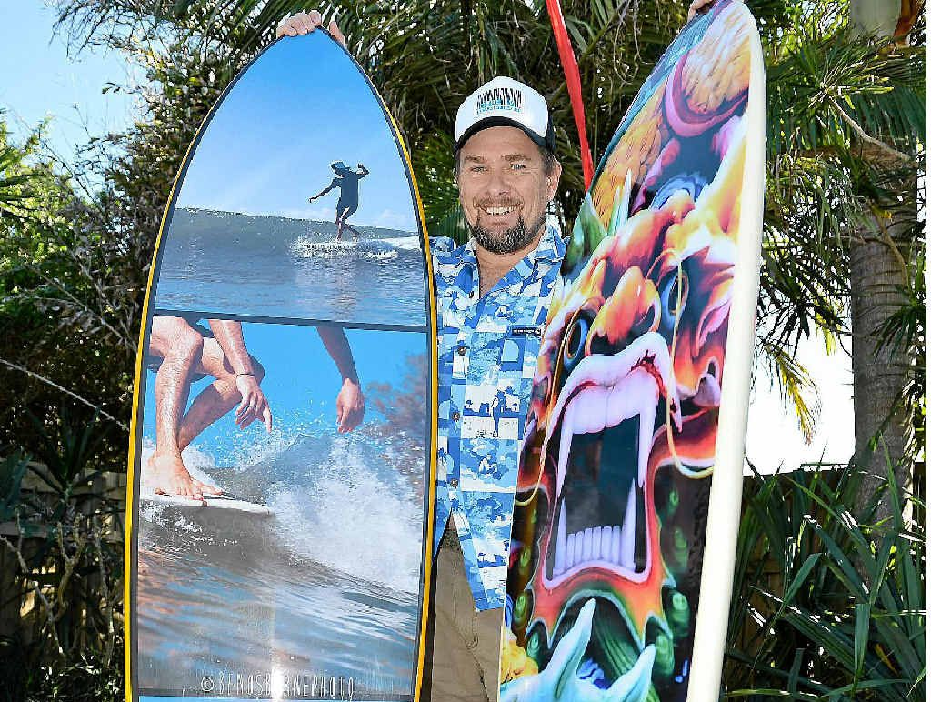 NEW YORK EXPOSURE: Dave West with his colourful surfboard stickers.