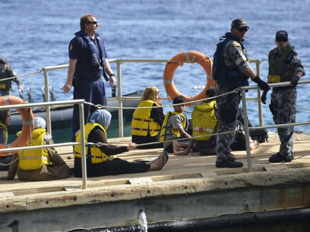 UNKNOWN FUTURE: Asylum seekers are transported to Christmas Island in 2012 after their boat issued a distress signal.