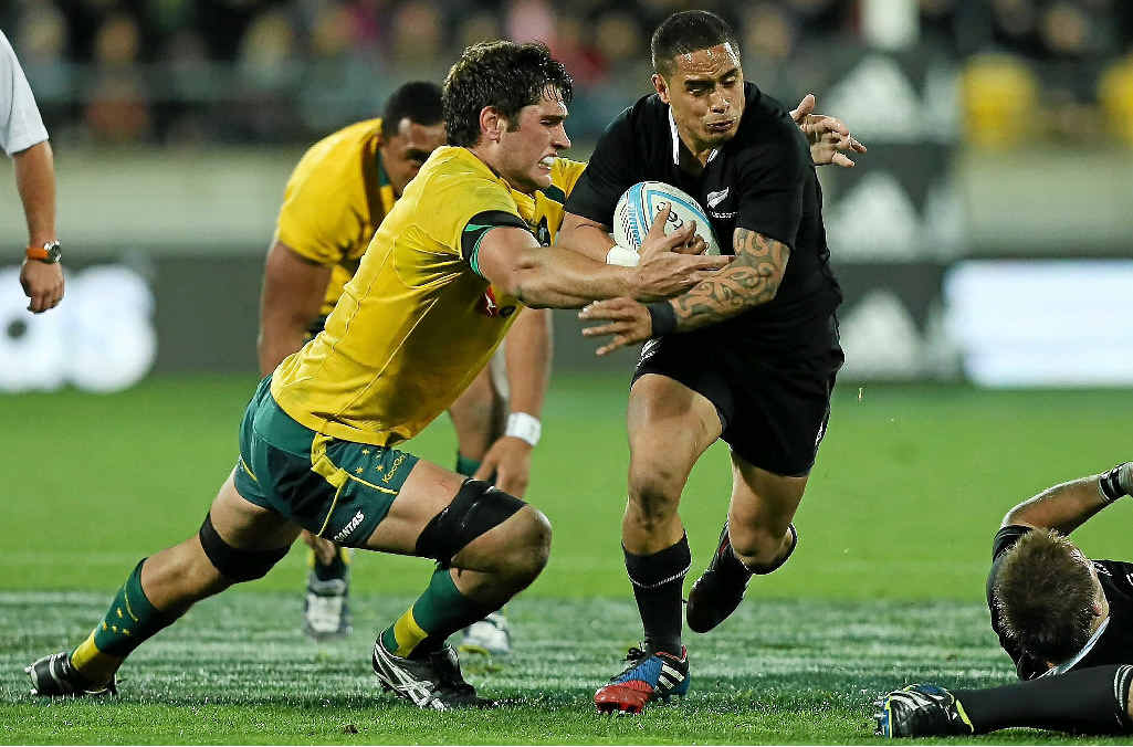 DESPERATE TIMES: The All Blacks' Aaron Smith cops a solid tackle from the Wallabies' Rob Simmons in last night's Bledisloe Cup match in Wellington.