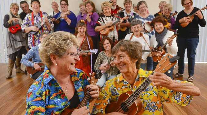 TUNE IN: Madge Little and Jan Taylor strike a pose in front of the Grafton Ukettes at the weekly meeting at Joan Muir Community Hall. Photo: Adam Hourigan