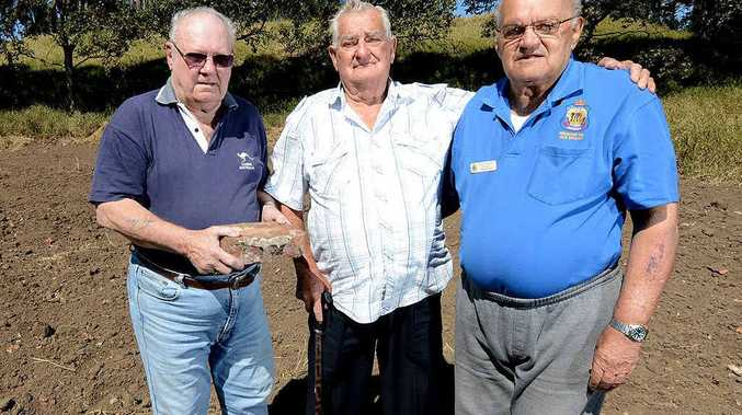 ANGRY: Redbank RSL life member Bill Bowtell (middle) with the vice president George Rant and president Rick Gross at the site where Main Roads have destroyed a heritage-listed pistol range wall.