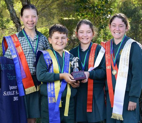 WINNERS: St Brigid's Rosewood students Brooke Dougall, Jack Davis, Paige and Bella Koroloff are the Matthew Flinders Anglican College primary school show jumping champion team. INSET: The students after the competition.