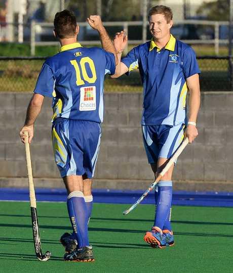 FAREWELL SUPPORT: Regular Hancocks goal-scorer Adam McClelland (right) congratulates teammate Peter Mitchell after scoring in Saturday's A-grade match.