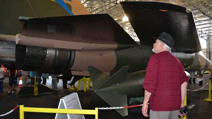 UP CLOSE: Darcy Williams looks over the F-111 on display at the Evans Head aviation museum.