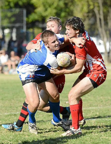 TACKLED: Byron Bay's Tim Foster and Ryan O'Connell tackle a Grafton Ghost player during the match at McGuren Park on Saturday.