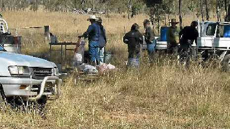 COUNCIL ASSISTANCE: Twenty landholders received their baits at the council Risdon/Murray Bridge wild dog, fox and feral pig baiting station last Thursday.
