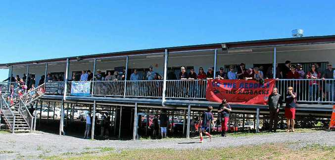 A large crowd gathered on the balcony of the new clubhouse to watch as Lawrence Springborg cut the ribbon on Saturday.