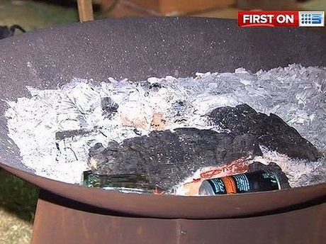 Two teenagers were injured when a boy allegedly poured an accelerant onto a bonfire.