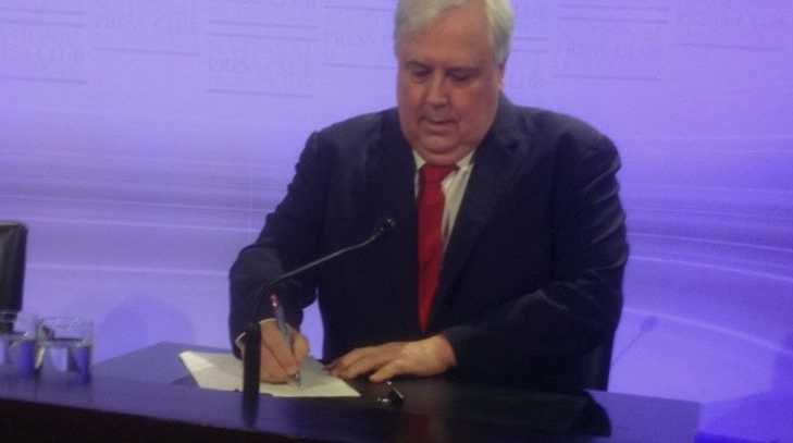 Clive Palmer works on his speech ahead of a National Press Club debate with Bob Katter.