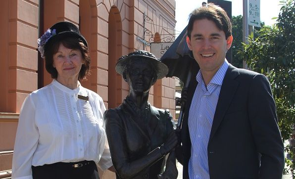 Proud Marys president Shirley Sengstock and councillor George Seymour with the Mary Poppins statue outside the birthplace of author P.L. Travers in Maryborough.