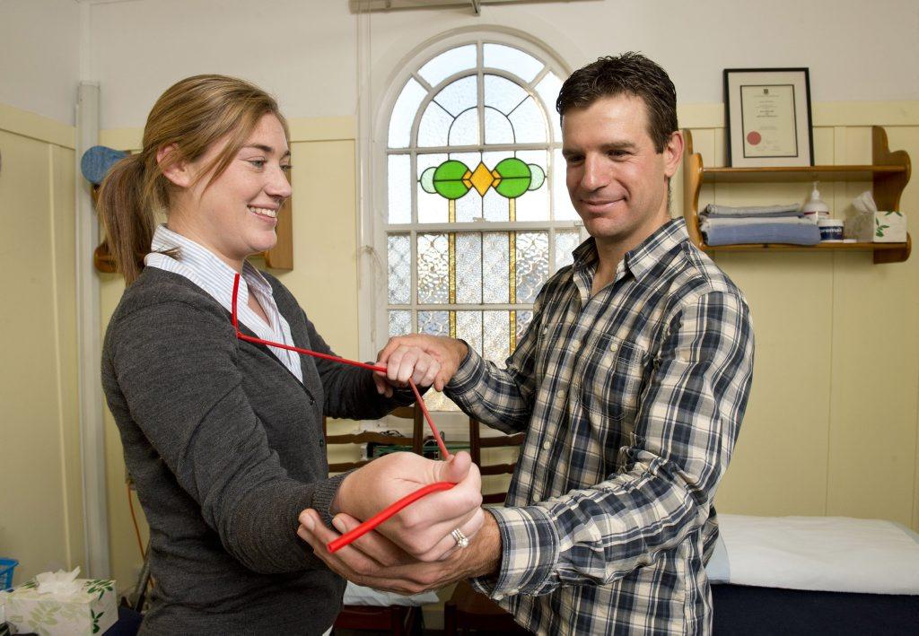 James Wiltshire treats patient Kate Scudamore at Wiltshire Health Centre.
