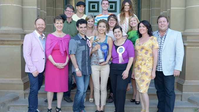 Bake Off winner Nancy Ho pictured with her fellow contestants, judges and the show's hosts.