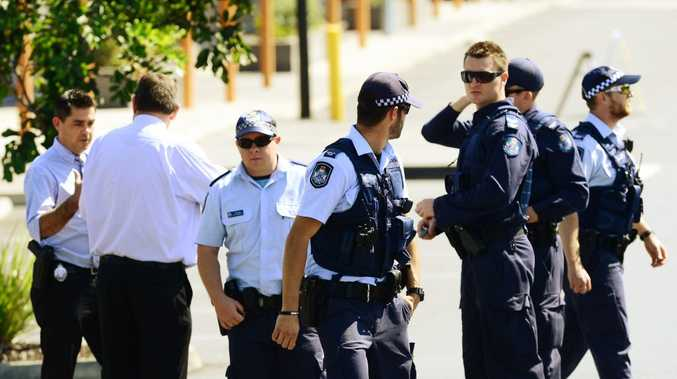 Police evacuate the Home HQ centre in West Ipswich after a suspicious device was found in a garden bed. Photo: David Nielsen / The Queensland Times