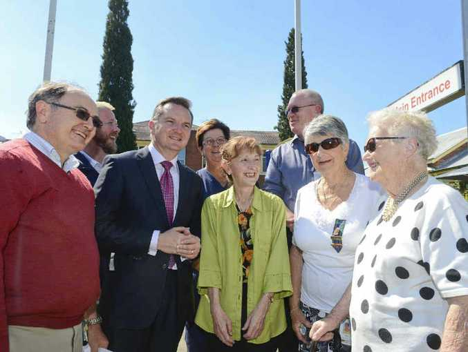 HEALTHY SMILES: Treasurer Chris Bowen and Janelle Saffin surrounded by people happy to hear of the $10 million in funding announced yesterday for the stage 3 improvements at Grafton Base Hospital.Photo: Adam Hourigan