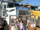 FAMILY DAY: This 2013 model T909 Kenworth was still being polished to an inch of its life by dad Darin Payne and his kids Braden and Ella when it arrived at the Weethalle truck show on Sunday August 18. Darin drives for Chamen's Transport of Condobolin, hauling grain and fertilizer all over the country. He said the show was a chance to have a day out with the family and support his mates who organised the day.