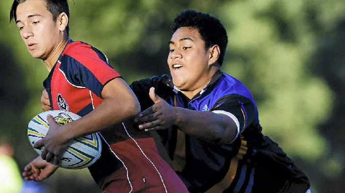 TENSE: Ipswich State High School year 9s tackle Yeronga High at Karalee in the Metro Cup today.