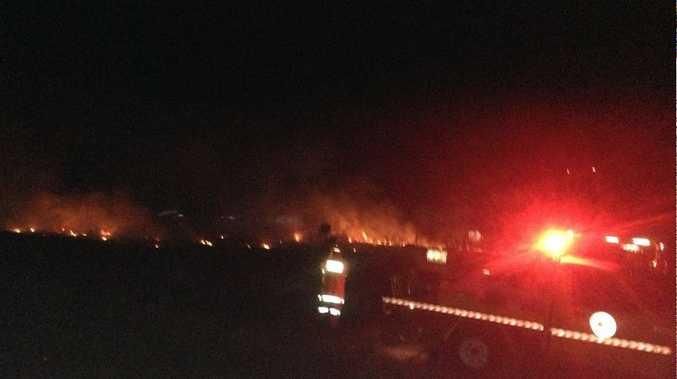 Crews fighting a fire off the Maryborough-Hervey Bay Rd at Nikenbah.