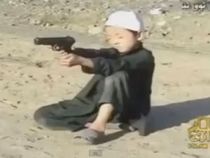 Video shows children firing guns at terrorist training camp
