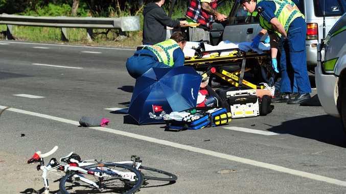Paramedics attend a cyclist hit by a car on Noosa Eumundi Road near the corner of Beddington Road.