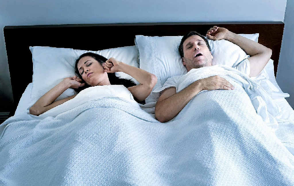Cuddling up to your partner is a no-no, even if they don't snore.