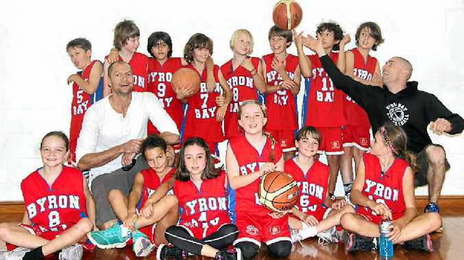 TOP EFFORT: Celebration time for happy Byron Bay junior basketballers and coaches after a great performance at this year's North Coast Classic Shield.