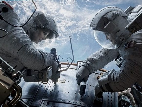 Sandra Bullock and George Clooney in a scene from the movie Gravity.