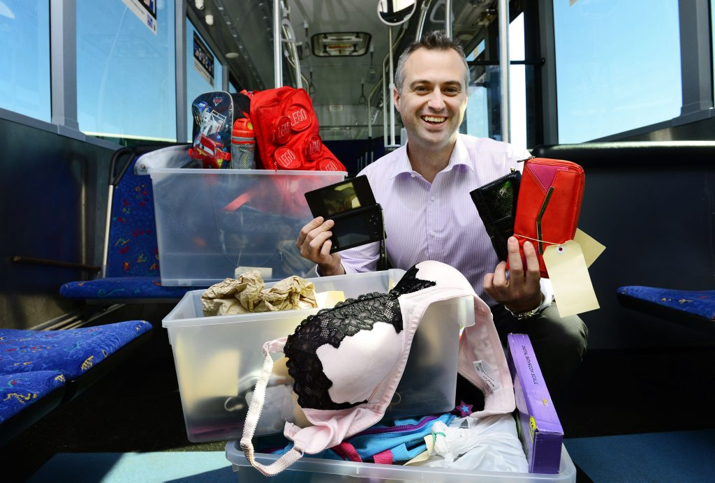 LOST PROPERTY: Westside Bus Company general manager Mark Thatcher with boxes of lost property left on buses.