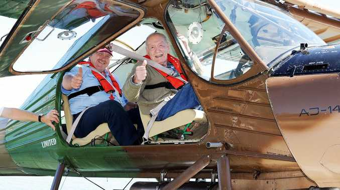 Neighbours Steve Dunn and David Howorth taking a joy flight in a Paradise Seaplane at Gatakers Bay.
