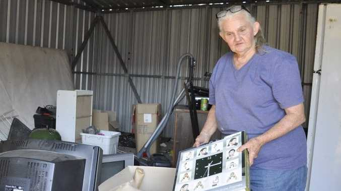 Landlord Von Souvlis cleans up some of the mess left in a shed by a tenant in her Drayton rental property.