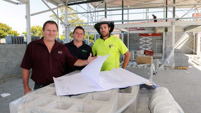 Torquay Hotel general manager Darren Carter, retail manager Scott Carter and SX Projects site manager Nick Steel look over redevelopment plans.