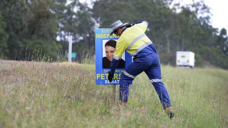 Dr Patricia Petersen's sign is removed from the Cunningham Highway near Swanbank.