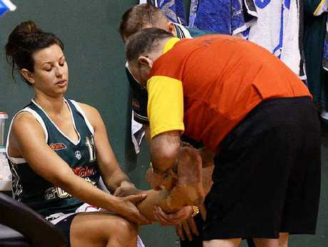 QUICK PATCH-UP: Ipswich Force forward Emma Langford receives treatment after injuring her left ankle in last weekend's state league quarter-final at Booval.