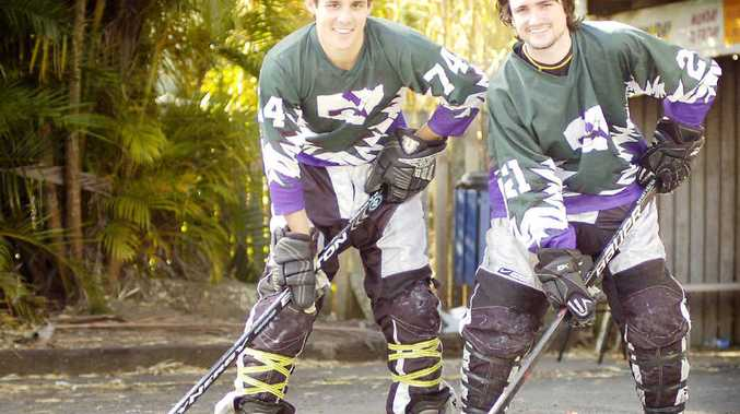 TIME OUT: Relaxing after a hard day on the rink at the Lismore Inline Hockey Tournament are players Matt Cramp (left) and Simon Leader.