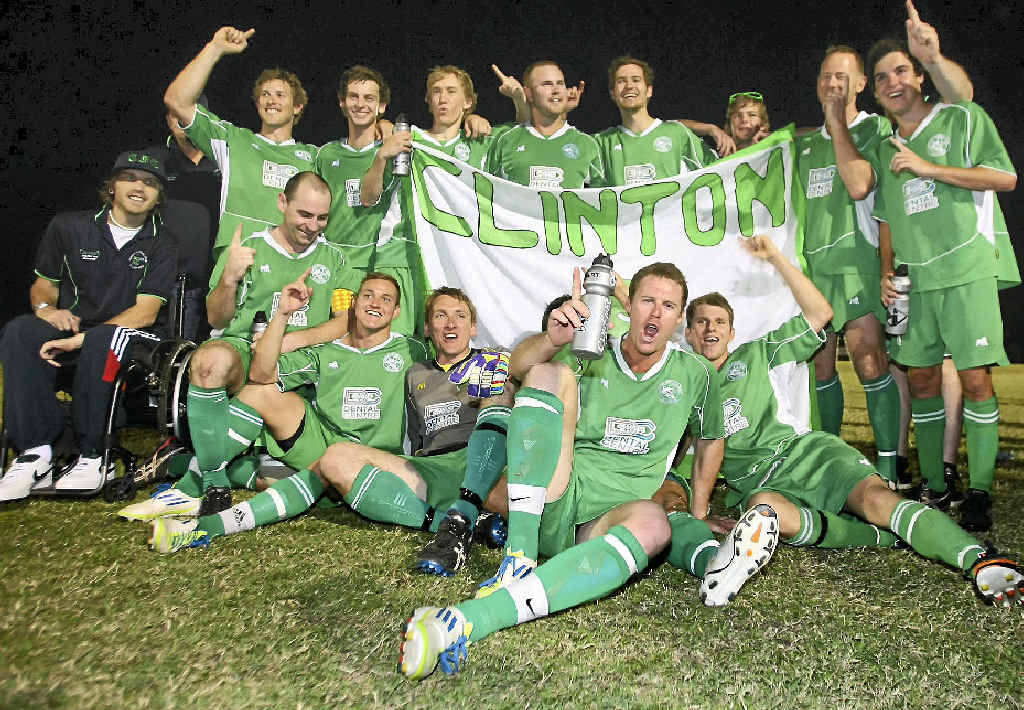 HAPPY CHAPPIES: Clinton soccer team celebrate their grand final win last year.