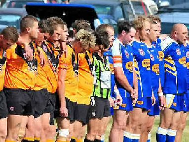 Avondale and Agnes Water line up for the national anthem before the start of the Northern Districts grand final at Gin Gin Sports Ground last Sunday.