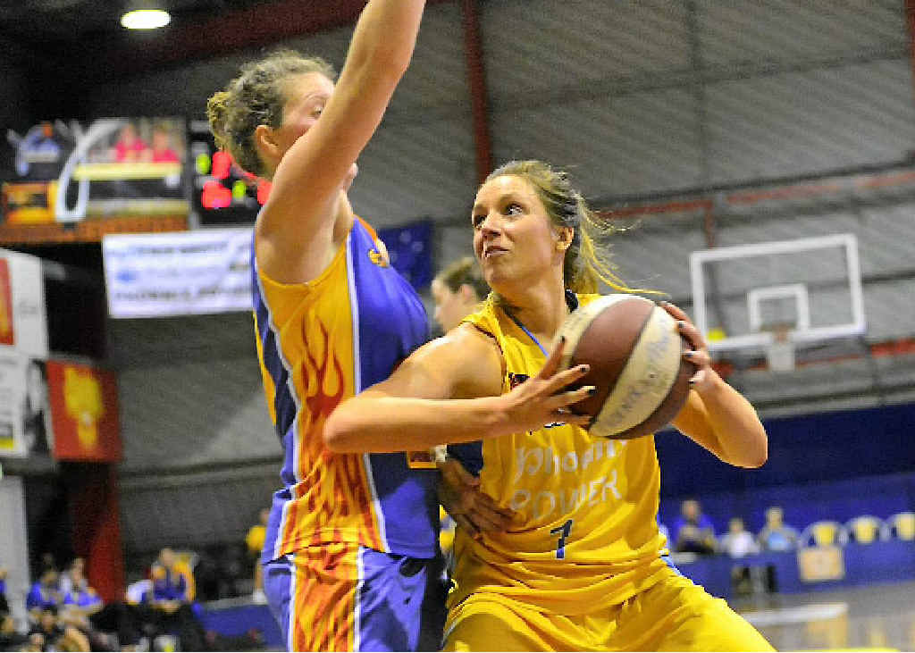 MUSCLING UP: Power's Rachel Pryor attempts to get around an opponent.