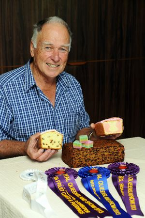 Maryborough's Robert Ullmann with his cakes, sweets and ribbons from the Ekka.