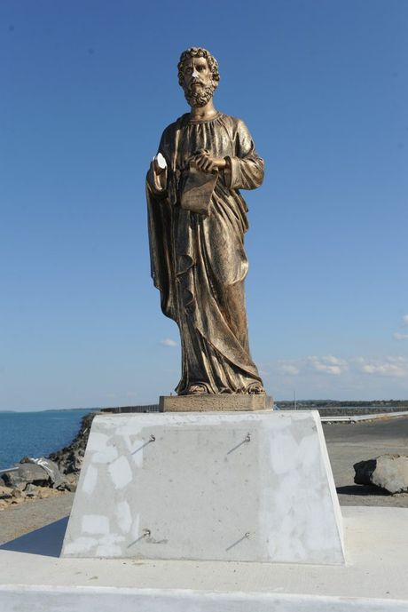 The statue of St Peter lost its nose, hand and a plaque in the attack by vandals.