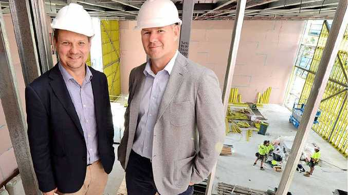 SHOWN AROUND: Managing director of Leda Holdings, Rob Ell (right) shows Limelight Cinemas managing director Ross Entwistle through their new Riverlink Shopping Centre project.