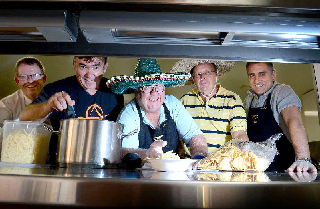 FOOD FUN FOR FATHERS: Earning their Father's Day presents by working in the Alstonville High School canteen are principal David Silcock, Geoff Browning of Wollongbar and Ric Howard, Greg Fowler and Roo Mackerras, all of Alstonville.