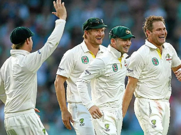 SUPER SERIES: Ryan Harris, right, gets a pat on the back from skipper Michael Clarke, with a happy Shane Watson not far behind, after taking the wicket of Kevin Pietersen on the final day of the fifth Test in England.