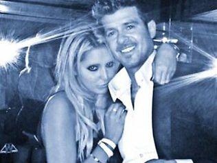 Robin Thicke with a blonde on his arm caught out by a mirror reflection. Source: Twitter