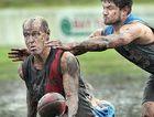 MUD BATH: Alistair Brightman won a prestigious award for this AFL photo.