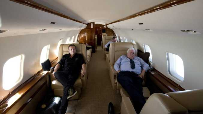 AAP Photographer Dave Hunt (left) travels with the Palmer United Party Leader mining magnate Clive Palmer, as he catches up on some sleep between campaigning, aboard his $70 million private jet, Wednesday, August 28, 2013. (AAP Image)